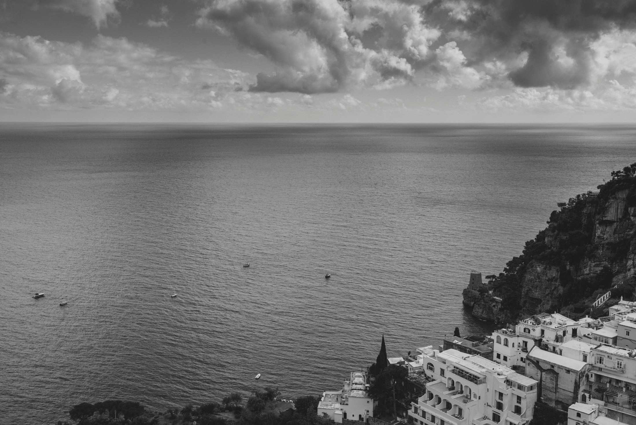 black and white landscape with the sea and positano