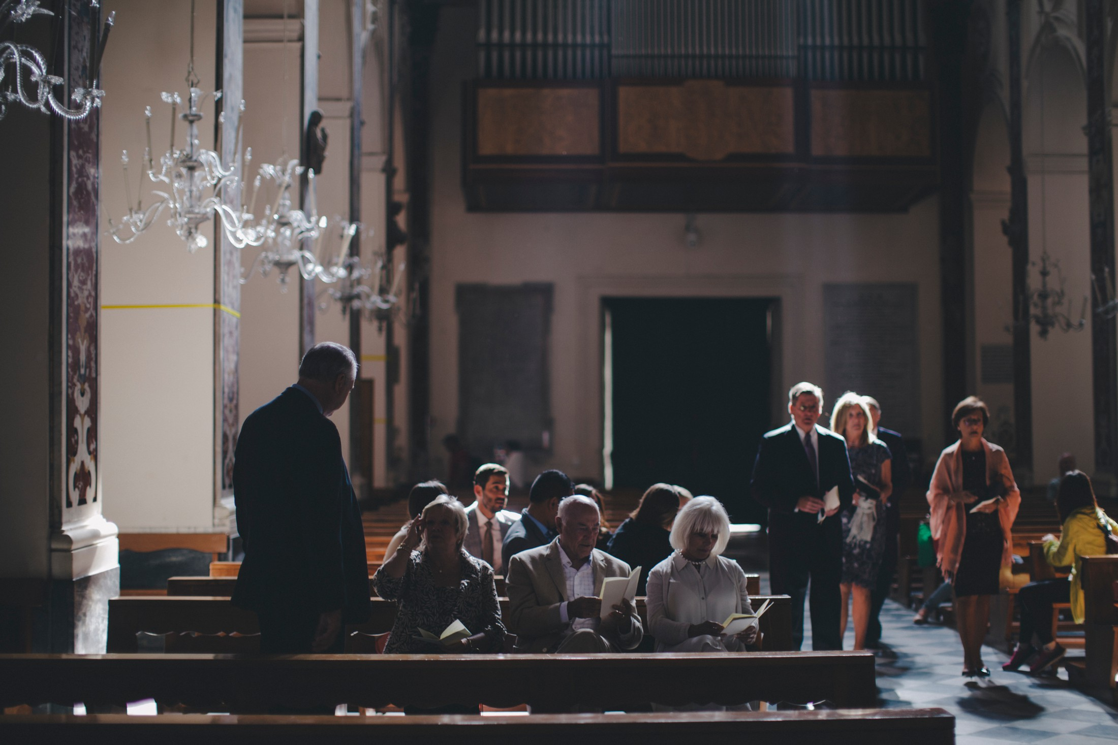 wedding guests enter the church