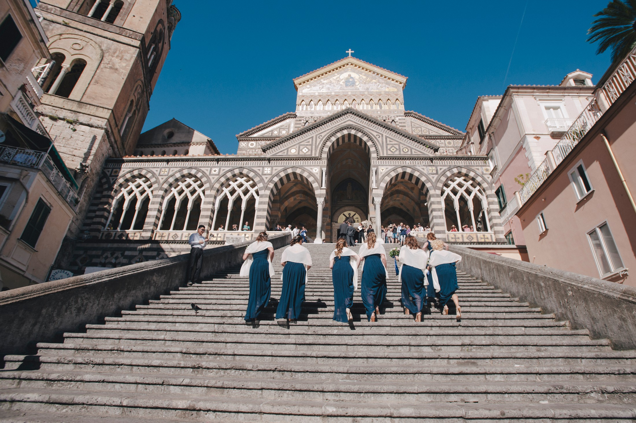bridesmaids going up the the amalfi cathedral