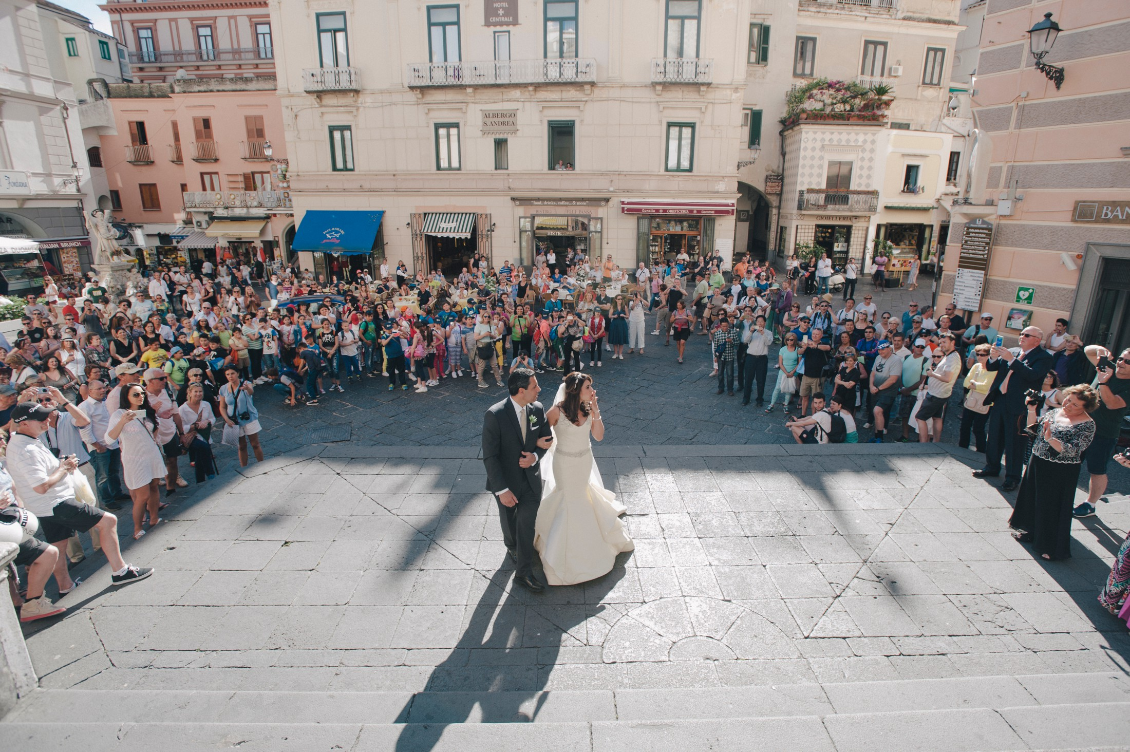 the bride walks to the amalfi cathedral with her father