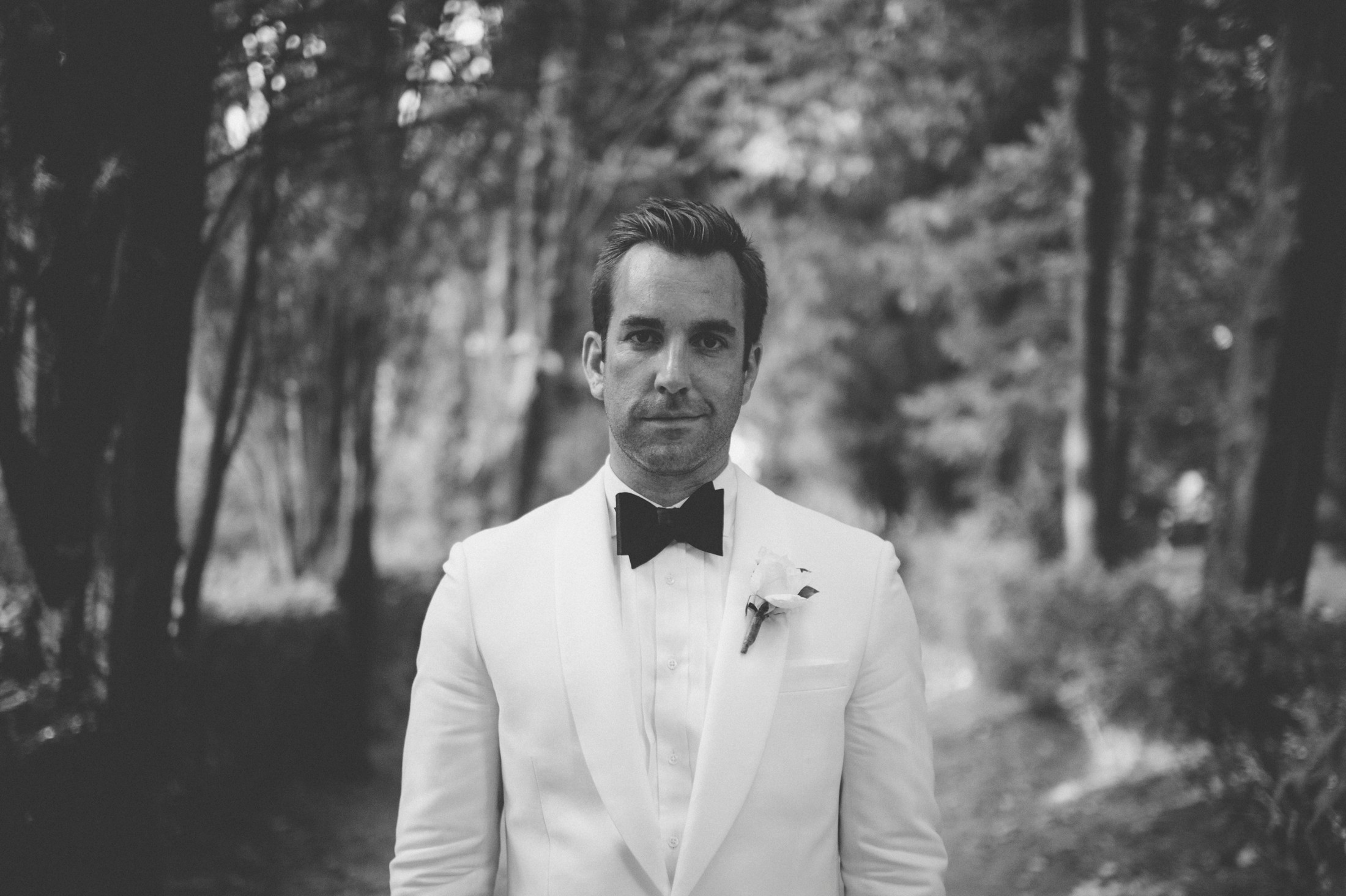 groom's portrait in the pine groove at villa cimbrone black and white