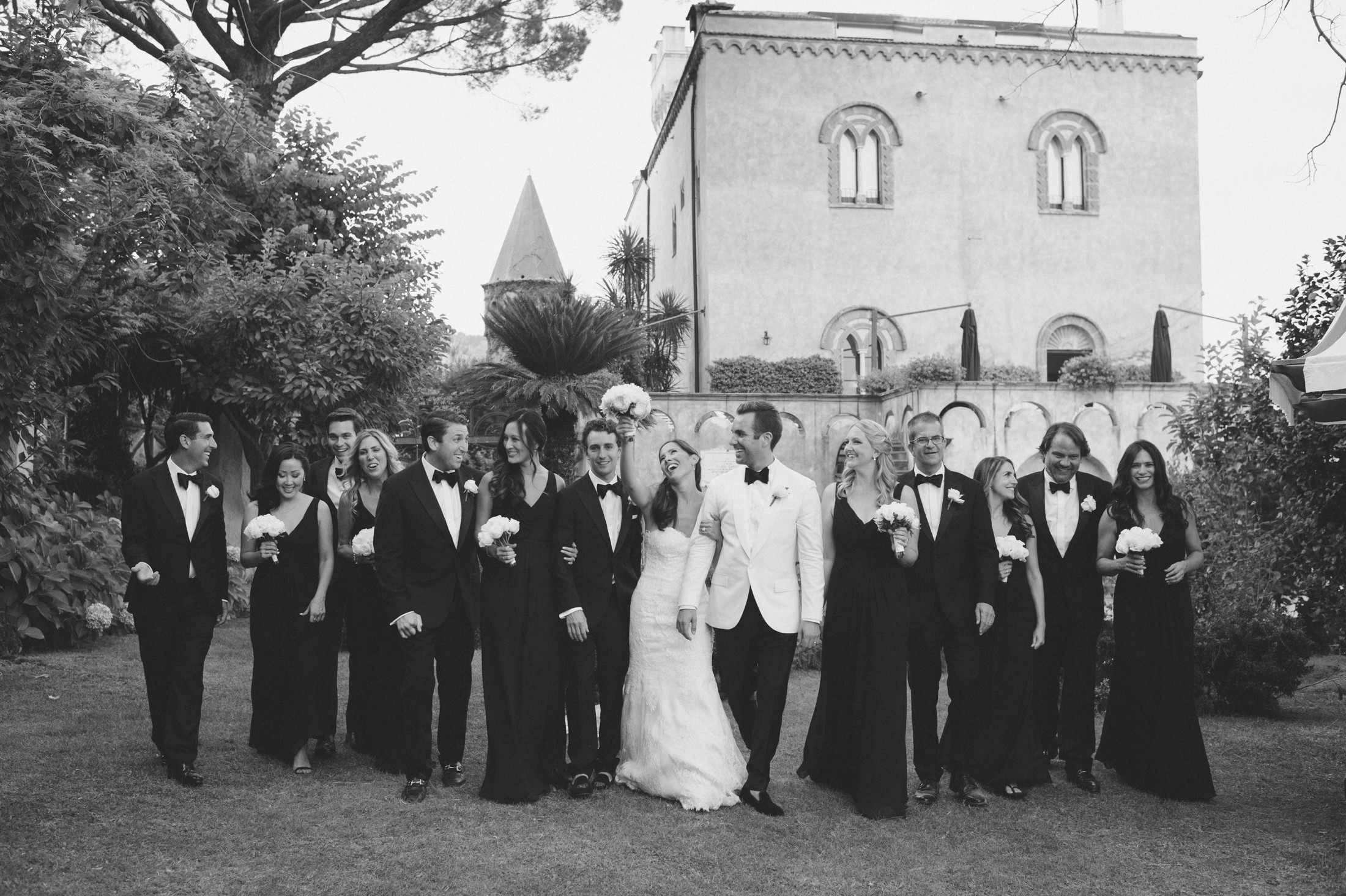 the bride and the groom with their best men and bridesmaids