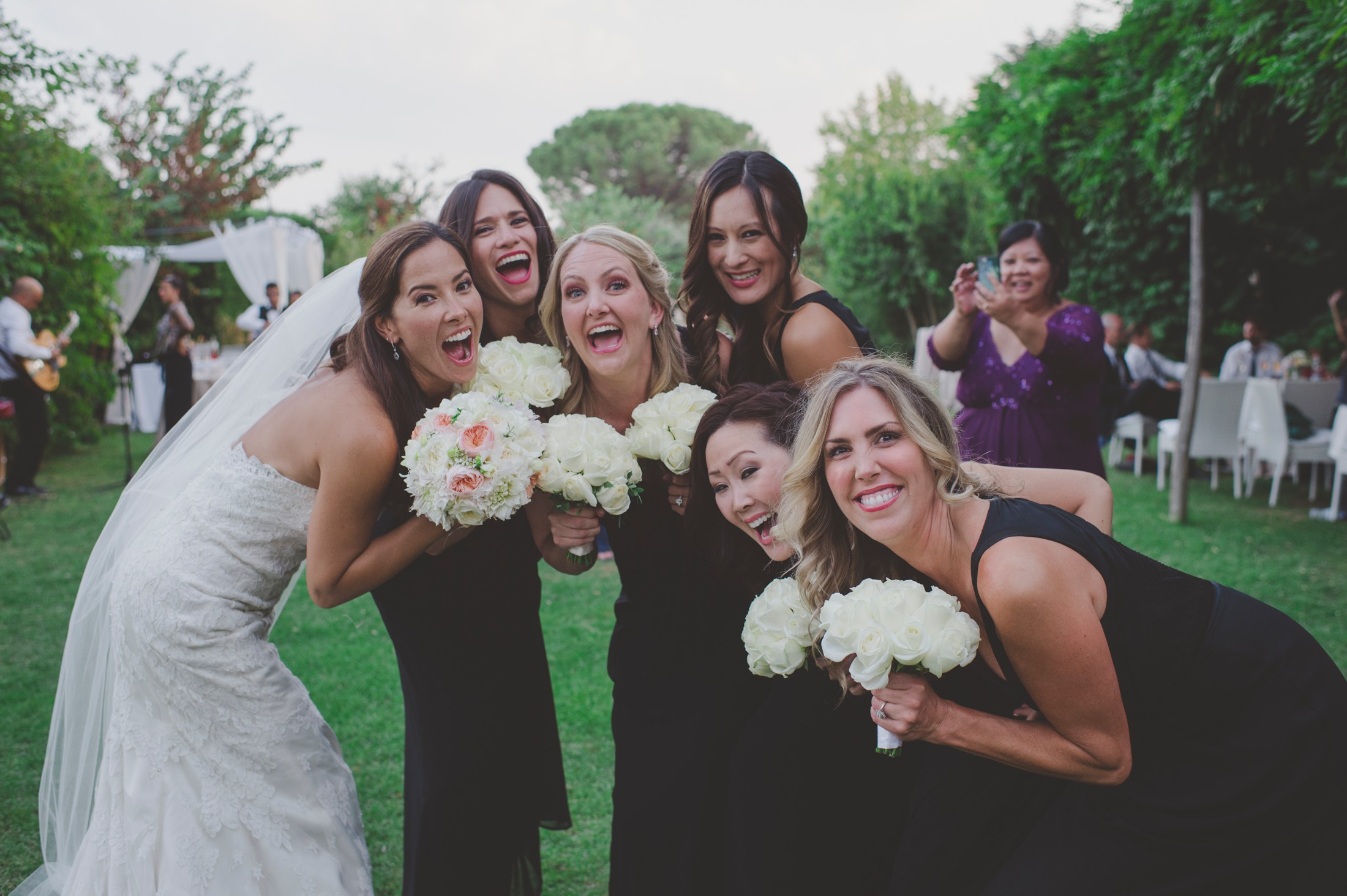 the bride smiling with the bridesmaids